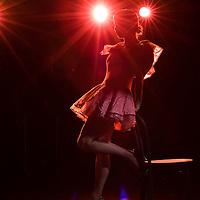 Dancer on stage in spot light