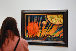 "© Licensed to London News Pictures. 07/02/2017. London, UK. A visitor views ""New Planet"" by Konstantin Yuon at the preview of an exhibition entitled ""Revolution Russian Art 1917-1932"", which marks the centenary of the Russian Revolution.  The exhibition runs from 11 February to 17 April 2017 at the Royal Academy of Arts in Piccadilly. Photo credit : Stephen Chung/LNP"