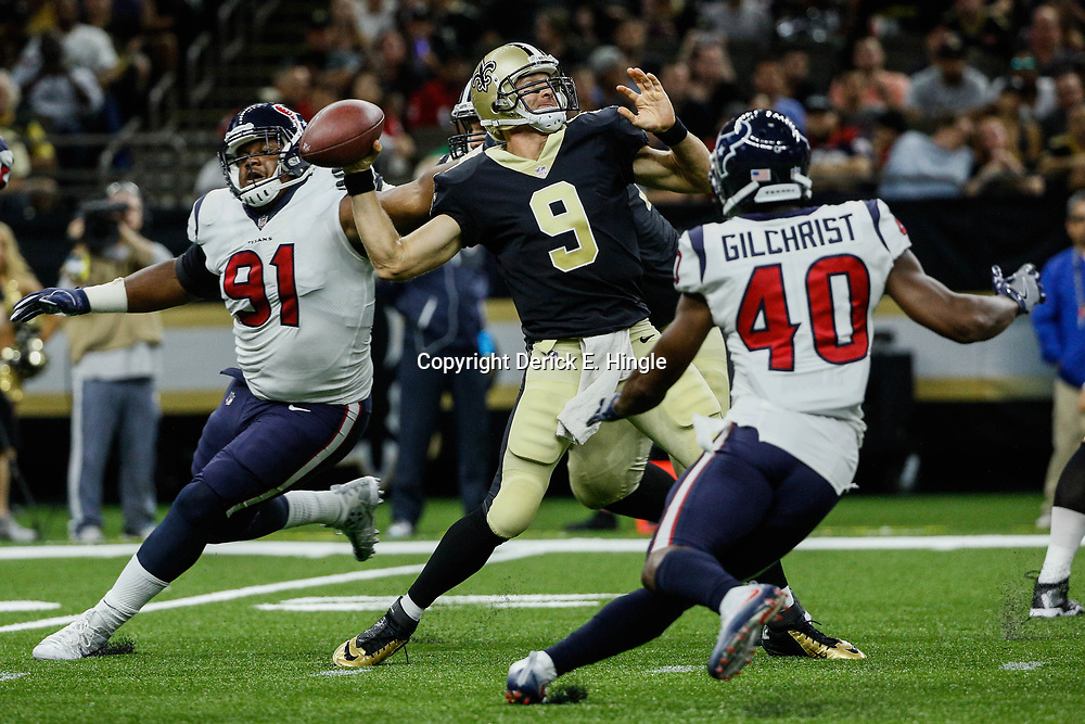 Aug 26, 2017; New Orleans, LA, USA; New Orleans Saints quarterback Drew Brees (9) throws as Houston Texans defensive tackle Carlos Watkins (91) and safety Marcus Gilchrist (40) pressure during the second quarter of a preseason game at the Mercedes-Benz Superdome. Mandatory Credit: Derick E. Hingle-USA TODAY Sports