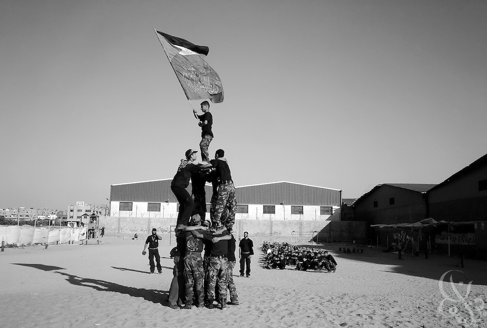 Young Palestinian boys form a human pyramid during an August 05, 2007 HAMAS sponsored summer camp in the Nuseirat camp in the Gaza strip. Up to 100,000 kids from age 7-16 are given military style training 6 days a week at  Hamas camps across the Gaza strip  for 3 hours per day.
