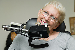 Portrait of woman with Cerebral Palsy and her personal environment controls,