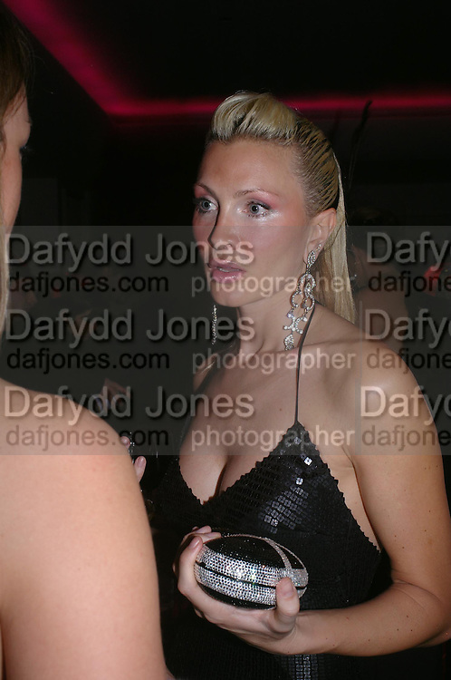Caprice Bourret.  Andy & Patti Wong's Chinese New Year party to celebrate the year of the Rooster held at the Great Eastern Hotel, Liverpool Street, London.29th January 2005. The theme was a night of hedonism in 1920's Shanghai. . ONE TIME USE ONLY - DO NOT ARCHIVE  © Copyright Photograph by Dafydd Jones 66 Stockwell Park Rd. London SW9 0DA Tel 020 7733 0108 www.dafjones.com