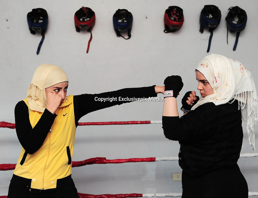 DAMASCUS,<br /> <br /> Syria's first women's national boxing team<br /> <br /> A Syrian woman boxer exercises at the government-run al-Nidal Club in Damascus, capital of Syria, on Nov. 19, 2016. Around 15 women now joined the club, from whom the main members of Syria's first women's national boxing team will be selected. Other provinces are expected to create similar clubs for women to finally form a women's national boxing team.<br /> ©Exclusivepix Media