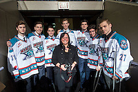 KELOWNA, CANADA - MARCH 21: Cindy Rogers smiles for a birthday photo with players of the Kelowna Rockets on March 21, 2015 at Prospera Place in Kelowna, British Columbia, Canada.  (Photo by Marissa Baecker/Shoot the Breeze)  *** Local Caption *** Cindy Rogers;