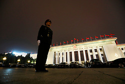 epa06270810 A Chinese People's Liberation Army (PLA) soldier stand guard outside the Great Hall of the People (GHOP) where the 19th National Congress of the Communist Party of China (CPC) will be held in Beijing, China, 17 October 2017. The five-yearly 19th National Congress of the Communist Party of China (CPC) will begin on 18 October.  EPA-EFE/HOW HWEE YOUNG