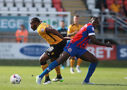 Newport County striker Lenell John-Lewis get the better of Dagenham central defender Nyron Nosworthy during the Sky Bet League 2 match between Dagenham and Redbridge and Newport County at the London Borough of Barking and Dagenham Stadium, London, England on 19 September 2015. Photo by Bennett Dean.
