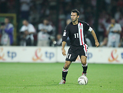 WARSAW, POLAND - WEDNESDAY, SEPTEMBER 7th, 2005: Wales' Ryan Giggs in action against Poland during the World Cup Group Six Qualifying match at the Legia Stadium. (Pic by David Rawcliffe/Propaganda)