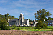 Ancient typical Norman style church and village at Vaux-sur-Aure in Normandy