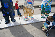 United Buddy Bears exhibition in front of Karlskirche, Vienna. M: Korea, bear by Seo Soo-Kyoung..An idea on its tour around the word: 137 Buddy Bears, created in Berlin/Germany, are standing peacefully hand in hand to represent 137 United Nations member states. An exhibition under the motto WE HAVE TO GET TO KNOW EACH OTHER BETTER it makes us understand one another better, trust each other more and live together more peacefully..The idea for this exhibition was created 2002 by the inventors of the Buddy Bears Eva and Klaus Herlitz. More than 140 artists, each one coming from the country his bear represents, show the art style of their home countries. Standing in a circle the bears form a unique work of art altogether. The individual design of each bear includes a lot of information about the different countries. Together with the symbolism of the circle love, peace, friendship, tolerance and international understanding are promoted. In each city where the circle is shown activities (e.g. auctions) raise money for children in need. .At the end of the world tour and in between the bears will be sold by charitable auction for UNICEF and other organisations helping needy children all over the world.