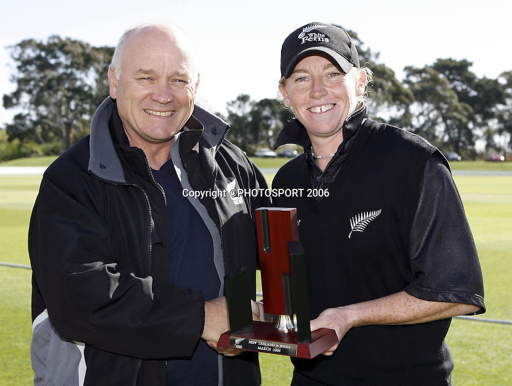 High Performance Manager of New Zealand Cricket Richard Charlesworth awards White Ferns Captain Haidee Tiffen the trophy for winning the series after the one day cricket match between the New Zealand White Ferns and India at Lincoln University on Monday 13 March 2006. Photo: Simon Fergusson/PHOTOSPORT