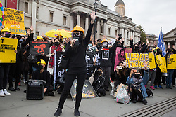 London, UK. 5 October, 2019. Activists from Democracy for Hong Kong protest in Trafalgar Square against the invocation by the government of Hong Kong of emergency regulations which prohibit protesters from covering their faces, wearing masks and using paint on their faces during protests.