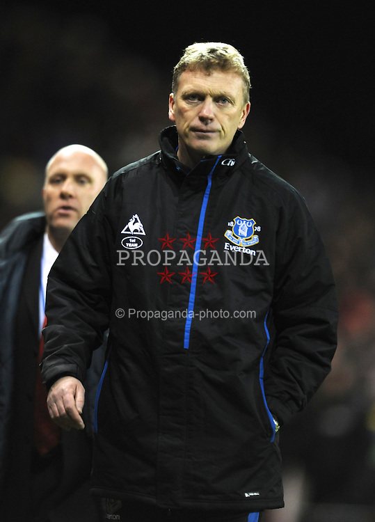 STOKE-ON-TRENT, ENGLAND - Saturday, January 1, 2011: Everton manager David Moyes looks dejected as he leaves the field following the Premiership match at the Britannia Stadium. (Photo by Chris Brunskill/Propaganda)