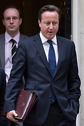 © licensed to London News Pictures. London, UK 26/06/2013. Prime minister David Cameron leaving Downing Street on Wednesday, 26 June 2013. Photo credit: Tolga Akmen/LNP