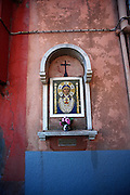 Catholic altar in the wall of a house at Murano, Venice, Italy