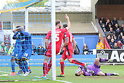 Lyle Taylor forward for AFC Wimbledon (33) and Bayo Akinfenwa forward for AFC Wimbledon (10) in action during the Sky Bet League 2 match between AFC Wimbledon and Crawley Town at the Cherry Red Records Stadium, Kingston, England on 16 April 2016. Photo by Stuart Butcher.
