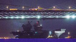 HMS Queen Elizabeth sets sail from Rosyth for sea trials.  Royal Navy's new aircraft carrier has left its home port for the first time, as the ship passed under the Forth Bridge just before midnight.