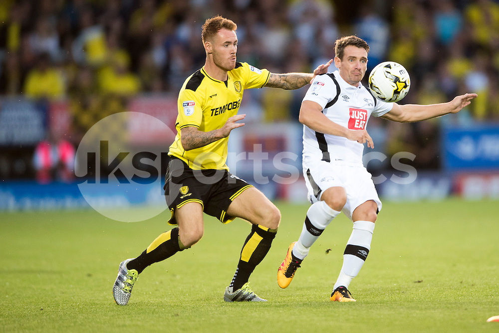 Craig Bryson of Derby County and Tom Naylor of Burton Albion compete for the ball during the EFL Sky Bet Championship match between Burton Albion and Derby County at the Pirelli Stadium, Burton upon Trent, England on 26 August 2016. Photo by Brandon Griffiths.