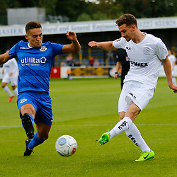 Dovers defender Jack Connors crosses the ball past Eastleighs defender Josh Hare during the National League match between Dover Athletic FC and Eastleigh FC at Crabble Stadium, Kent on 25 August 2018. Photo by Matt Bristow.