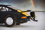 Image of a black 1975 Porsche 911 streamliner with a rainbow, Bonneville Salt Flats, World of Speed 2014, Utah, American Southwest