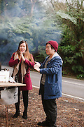 Couple roadside chestnut roasting Dandenong Ranges Melbourne