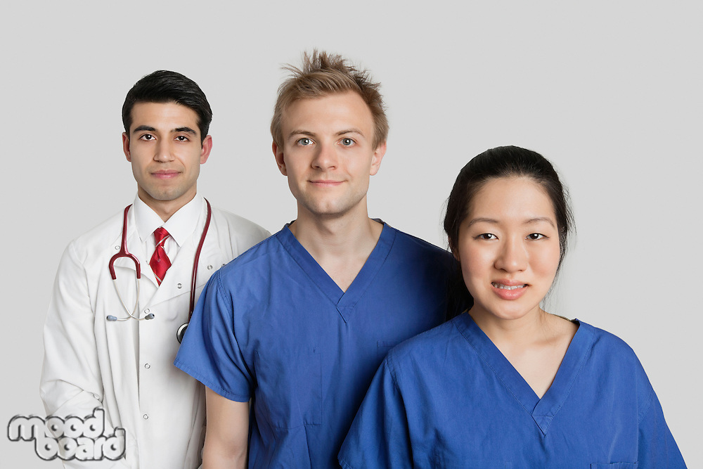 Portrait of diverse medical team standing over gray background