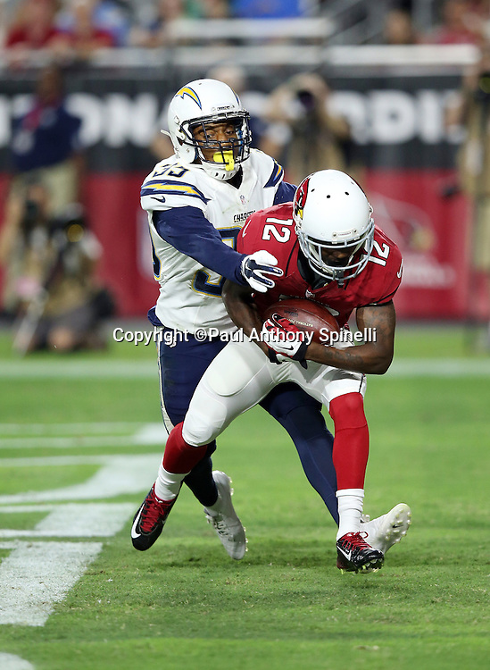 Arizona Cardinals wide receiver John Brown (12) catches a first quarter touchdown pass that gives the Cardinals a 6-0 lead while covered by San Diego Chargers cornerback Richard Crawford (35) during the 2015 NFL preseason football game against the San Diego Chargers on Saturday, Aug. 22, 2015 in Glendale, Ariz. The Chargers won the game 22-19. (©Paul Anthony Spinelli)