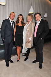 Left to right, SHANE WARNE, ELIZABETH HURLEY, LOUISE FENNELL and THEO FENNELL at a party to celebrate the publication of Fame Game by Louise Fennell held at Grace, West Halkin Street, London on 12th March 2013.