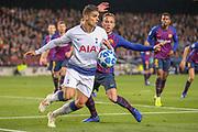 Tottenham Hotspur midfielder Erik Lamela (11) shields the ball from Barcelona midfielder Arthur (8) during the Champions League Group B match between Barcelona and Tottenham Hotspur at Camp Nou, Barcelona, Spain on 11 December 2018.