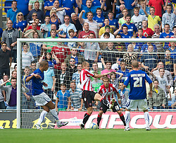 CARDIFF, WALES - Sunday, August 8, 2010: Cardiff City's Jay Bothroyd (L) scores the equalising goal against Sheffield United during the League Championship match at the Cardiff City Stadium. (Pic by: David Rawcliffe/Propaganda)
