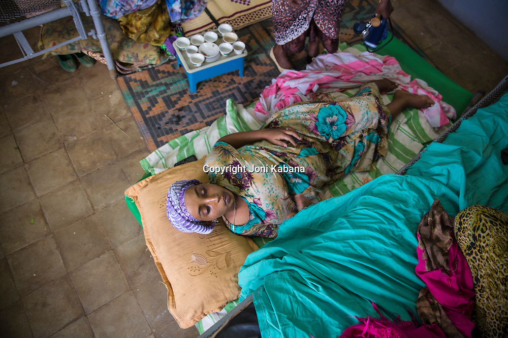 A woman rests between contractions in a health center in Jarso, Ethiopia. She was brought there because she was suffering from obstructed labor and knew that Hamlin midwives worked at this remote health post and could save her life.