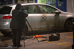 ©Licensed to London News Pictures 09/12/2019. <br /> Chislehurst,UK. Burn marks on the side of a silver car with a red petrol can on the ground.  Man sets himself on fire outside The Queens Head pub in Chislehurst High Street, Chislehurst, South East London. A police cordon is in place. Photo credit: Grant Falvey/LNP