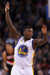 Feb 15, 2012; Oakland, CA, USA; Golden State Warriors point guard Nate Robinson (2) celebrates after making a three point basket against the Portland Trail Blazers during the second quarter at Oracle Arena. Mandatory Credit: Jason O. Watson-US PRESSWIRE