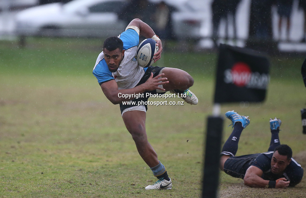 Grammar TEC wing Sitiveni Ramatalei tries to stay on his feet after being hit by College Rifles five eighth Orene Ai'i during the College Rifles vs Grammar TEC premier semi final rugby match played at Orakei Domain. Grammar TEC won 26-0. <br /> Credit; www.photosport.co.nz