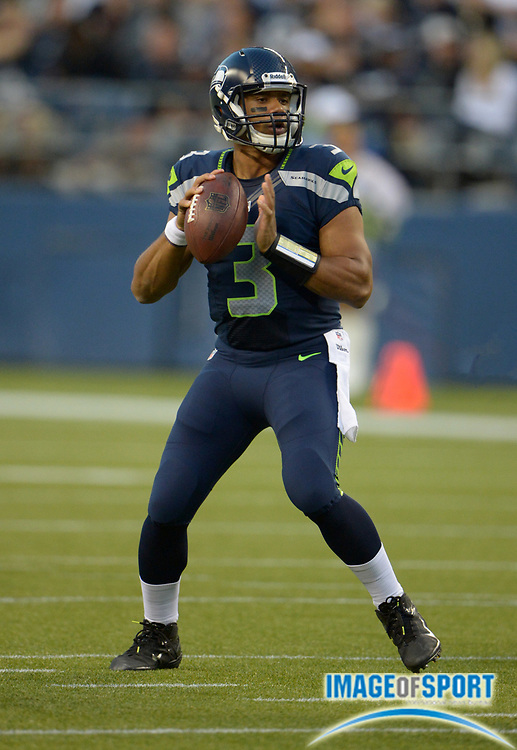 Aug 30, 2012; Seattle, WA, USA; Seattle Seahawks quarterback Russell Wilson (3) throws a pass against the Oakland Raiders at CenturyLink Field.