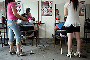 Chinese women work in a salon specializing in massage in Longnan, China.