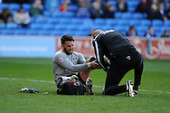 Charlton Athletic goalkeeper Stephen Henderson gets treatment for a leg/ankle injury in the 1st half. Skybet football league championship match, Cardiff city v Charlton Athletic at the Cardiff city Stadium in Cardiff, South Wales on Saturday 7th March 2015.<br /> pic by Andrew Orchard, Andrew Orchard sports photography.