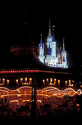 Cinderella's Castle at night, with carousel in foreground.