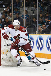 February 1, 2011; San Jose, CA, USA; Phoenix Coyotes defenseman Sami Lepisto (18) clears the puck against the San Jose Sharks during the first period at HP Pavilion. San Jose defeated Phoenix 5-3. Mandatory Credit: Jason O. Watson / US PRESSWIRE