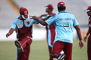 Kandurata Maroons players warm up during the Kandurata Maroons Training Session training session prior to the start of the Karbonn Smart CLT20 2013 held at the PCA Stadium in Mohali on the 15th September 2013<br /> <br /> Photo by Shaun Roy-CLT20-SPORTZPICS <br /> <br /> Use of this image is subject to the terms and conditions as outlined by the BCCI. These terms can be found by following this link:<br /> <br /> http://www.sportzpics.co.za/image/I0000SoRagM2cIEc