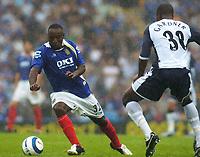 Photo: Alan Crowhurst.<br /> Portsmouth v Tottenham Hotspur. Barclaycard Premiership.<br /> 13/08/2005. Pompeys Lualua goes round Anthony Gardener.