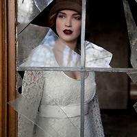 woman standing infront of a broken window