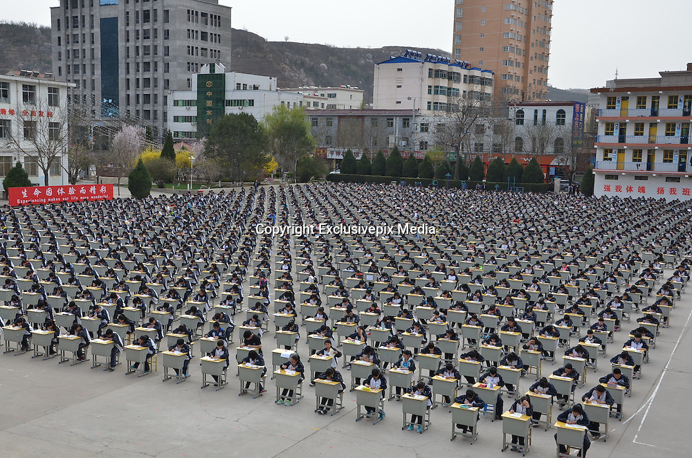 YAN'AN, CHINA - APRIL 11: (CHINA OUT) <br /> <br /> More Than 1,700 Students Take Outdoor Exam<br /> <br /> More Than 1,700 students take outdoor exam at the playground on April 11, 2015 in Yan'an, Shaanxi province of China. Yichuan Middle School held an outdoor exam with more than 1,700 examinees in Yan'an on Saturday.<br /> &copy;Exclusivepix Media