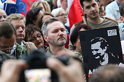 July 3, 2018 - Gdansk, Poland - Jaroslaw Walesa - Lech Walesa son in front of his father portrait is seen in Gdansk, Poland on 3 July 2018 People gather in front of Regional Court in Gdansk, to protest against governmental taking over the Supreme court and removing President of Supreme Court Malgorzata Gersdorf from office  (Credit Image: © Michal Fludra/NurPhoto via ZUMA Press)