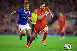 LIVERPOOL, ENGLAND - Wednesday, September 23, 2015: Liverpool's Adam Lallana in action against Carlisle United's Bastien Hery during the Football League Cup 3rd Round match at Anfield. (Pic by David Rawcliffe/Propaganda)