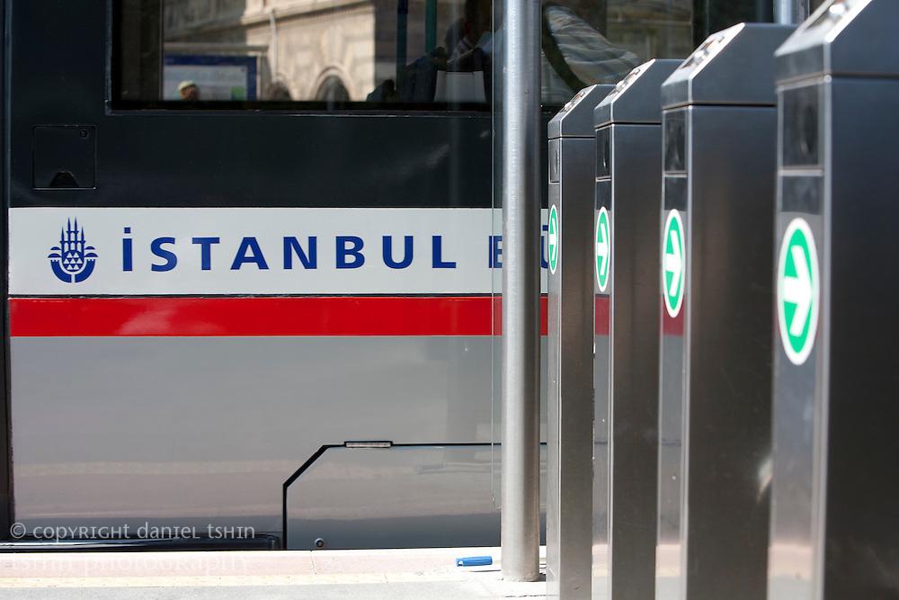 The side of an Istanbul tram as it leaves a tram station in Eminönü.