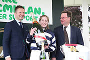 Miss Sophie Dods celebrates winning The Queen Mothers Cup (for Lady Amateur Riders) over 1m 4f (£20,000) with her weight in champagneduring the Macmillan Charity Raceday at York Racecourse, York, United Kingdom on 16 June 2018. Picture by Mick Atkins.