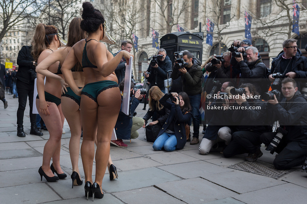 "Lingerie-clad models stage a protest by the animal rights organisation, Peta against the suffering of animals, on 17th Febriary 2017, in London, England, United Kingdom. The group stripped off into matching green underwear and crocodile masks before posing outside the show's main venue on the Strand in central London. Peta is campaigning against the use of exotic animal skins in the fashion industry. It follows an investigation of crocodile farms which found animals were confined to pits and sometimes still alive when their skin was torn off, Peta said. London Fashion Week is a clothing trade show held in London twice each year, in February and September. It is one of the ""Big Four"" fashion weeks, along with the New York, Milan and Paris. The fashion sector plays a significant role in the UK economy with London Fashion Week alone estimated to rake in £269 million each season. The six-day industry event allows designers to show their collections to buyers, journalists and celebrities and also maintains the city's status as a top fashion capital."