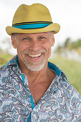 portrait of a handsome mature man in a fun hat