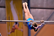 12 year old girl swinging on the uneven bars. Perth, Western Australia