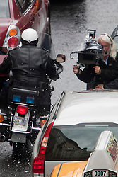 """Day two of filming. The police motorbike pass close to a cameraman on the set of the movie """"World War Z"""" being shot in the city centre of Glasgow. The film, which is set in Philadelphia, is being shot in various parts of Glasgow, transforming it to shoot the post apocalyptic zombie film.."""